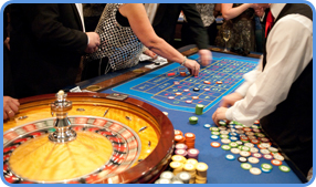 Roulette players and croupier at the traditional roulette table