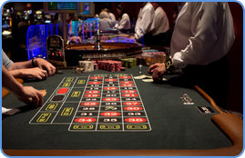 Players and croupier at the American roulette table