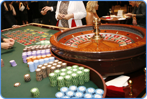 Playing roulette table game in the casino atmosphere