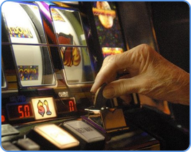 Player insert coin into the traditional slot machine
